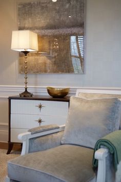 TThe three-drawer chest with Tony Duquette-inspired star pulls adds a modern element to a traditional piece of furniture. The painting above it is done in diamond dust.Tradional modern home by Lee W. Robinson Company.