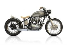 """Deus Ex """"The Sacred Crow"""": This is the same as our bobbersake BUT with Triumph T120 front drum brake, T120 petrol tank, classic headlight with stainless bracket, internal throttle assembly, steel rear fender with """"sparto"""" stop light, pea shooter pipes, 733 big bore kit with flowed head and clear coated bare metal."""