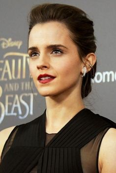 Looking for Emma Watson's maroon matte lipstick and dark curling mascara