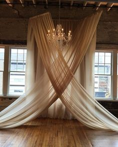 Loving the #draping classic #chandelier combo for this #snap! Photo via #brides #VicBonviciniPhotography