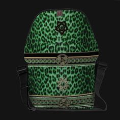 Luxurious Lucky Leopard in Celtic Kelly Green Bag  Green leopard skin, adorned with lace and jewels and ribbons and Celtic symbols of the cycle of life. Gold metallic trim along the edge of a string of emeralds brings together the green and black for a very luxurious Rickshaw Messenger Bag to carry your laptop or iPad, your phone. your planner and your life in an elegant, rugged and environmentally sustainable carrier. Matching sleeves for the Macbook or iPad available, as well.