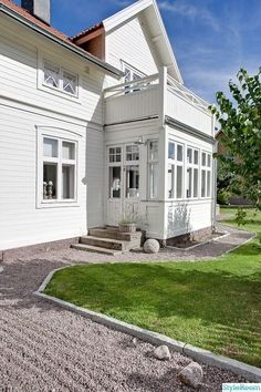 I like the sun room with it& balcony/deck roof. I like the sun room with it& balcony/deck roof. I like the sun room with it& balcony/deck roof. Balcony Curtains, Balcony Deck, Roof Deck, Swedish Cottage, Swedish House, House Extensions, Scandinavian Home, White Houses, House Goals