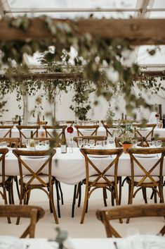 We love our Crossback Chairs - they look awesome!  Here they work beautifully with trestle table dining, white linen and greenery hanging from wooden beams under the clear roof marquee!  Hatch Marquee Hire supply stunning wedding marquees to Devon, Cornwall & Somerset.  Photo credit: Richard Skins Photography Wooden Trestle Table, Rustic Wooden Table, Trestle Tables, Wedding Hire, Tent Wedding, Wedding Themes, Wedding Reception, Dream Wedding, Wedding Ideas