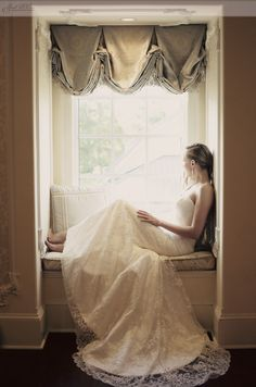 The window light in this image is beautifully showing the brides lace gown.The bridal suite at the Ashford Estate is perfect for candid wedding portraits. Image by Sarah DiCicco