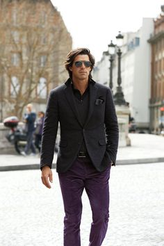 Try pairing a charcoal wool blazer with violet chinos if you're going for a neat, stylish look.  Shop this look for $231:  http://lookastic.com/men/looks/sunglasses-pocket-square-longsleeve-shirt-v-neck-sweater-blazer-belt-chinos/4288  — Grey Sunglasses  — Black and White Polka Dot Pocket Square  — Black Longsleeve Shirt  — Charcoal V-neck Sweater  — Charcoal Wool Blazer  — Black Leather Belt  — Violet Chinos