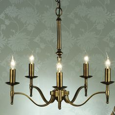 Traditional 5 arm chandelier in an antique brass finish.  Handmade in England to the highest quality.