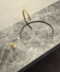 Vola tap - Wash basin in natural stone by Benoit Viaene