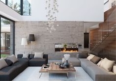 Modern living space with low couches, large open room