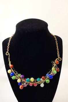 Crocheted wire and colorful glass handmade necklace. One of a kind. by GloriaynBoutique on Etsy