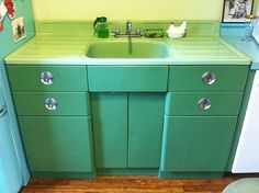 I always loved these metal cabinets and enamel sinks - I never could understand why people would replace them with wood and stainless steel. They're beautiful