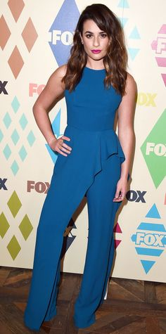 Lea Michele proved just how feminine a jumpsuit can be in this Elie Saab number detailed with a sleek cascading ruffle. Michele kept her accessories minimal and added to the look with a hot pink lip. Rachel Berry, Spencer Hastings, Celebrity Red Carpet, Celebrity Look, Blue Jumpsuits, Jumpsuits For Women, Zooey Deschanel, Anne Hathaway, Estilo Fashion