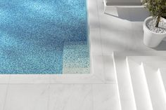 White marble and blue pixelated tiles. House M by Monovolume architecture + design.