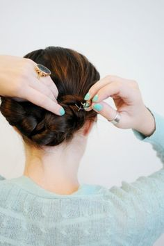 The Easiest Braided Updo You'll Ever TryTuck the remaining hair from the right side over the knot, and the hair from the left underneath. Both strands should be integrated into the initial knot. Then, use the Spin Pin to secure. Continue adding in pins until hair is held firmly in place.