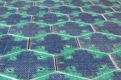 Eight years ago, Scott and Julie Brusaw had a vision of replacing the asphalt on American roadways and parking lots with energy-producing solar panels that are strong enough to withstand vehicular traffic. After a lot of experimentation and funding struggles, the couple and their company Solar Roadways just unveiled their first parking lot made of hexagonal panels!