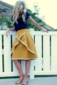 Elle Apparel: The Pinwheel Skirt DIY cotton pencil with over skirt wrap-style layered short skirt with contrasting edge. FREE sewing pattern and tutorial. You could easily color block this! It looks like a casual version of those short pencil skirts / column dresses with a full length voluminous over skirt - except this over layer is short too.