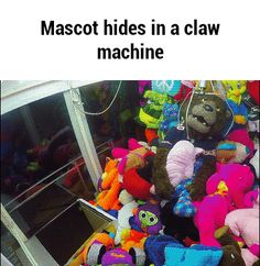 Mascot hides in a claw machine GIF