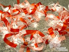 To make the lights more brilliant, bunch up several sections and tie together with ribbon while decorating the rest of the strand - easy way to dress up those cheap lights