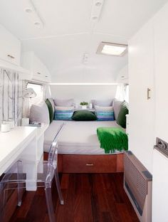Contemporary design of white bedroom in caravan