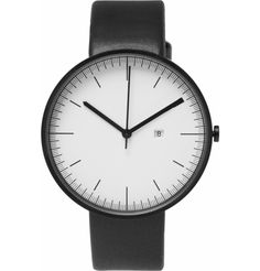 "Its black stainless steel case and minimalist face are complemented by a fine leather strap, while the quality Swiss-made jewel movement ensures you'll stay on schedule from morning till night. Wear it as part of a monochrome outfit for a touch of understated sophistication.  Face Diameter 1.57"" / 40mm"