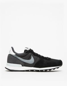 Internationalist from Nike with retro running shoe inspired silhouette in black and grey tones. Features nylon, mesh and suede uppers, padded collar, tall back, branded tongue, EVA midsole, supportive TPU heel and black rubber outsole.   •	Retro running