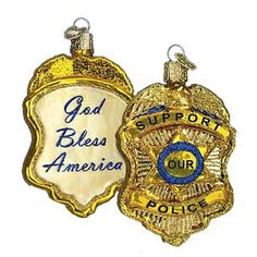 Police Badge Christmas Ornament 36129 Merck Family's Old World Christmas Introduced 2010 Gold Police badge ornament made of mouth blown, hand painted glass. Measures approximately
