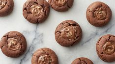 Easy chocolate cookies using a cake mix with melted Andes™ mints on top.