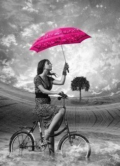 Touch of pink umbrella on a bike bicycle black white photograph