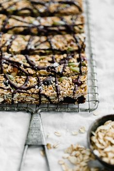 ... raw seedy granola bars made with oats, sunflower seeds, pepitas, sesame seeds, almonds, apricots, and honey, topped with a drizzle of dark chocolate...
