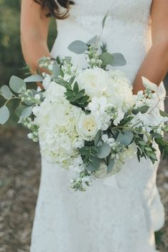 Elegant wedding bouquet  idea - white + cream flowers +  greenery bouquet - roses, hydrangeas, delphinium +  eucalyptus {OLLI STUDIO}