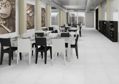 Cemento Bianco Rasato is a tile that emulates a concrete appearance. It's great for residential and commercial use, like in this modern restaurant layout. Restaurant Layout, Modern Restaurant, Porcelain Ceramics, Porcelain Tile, Tile Stores, Wall Tiles, Living Area, Countertops, Arizona