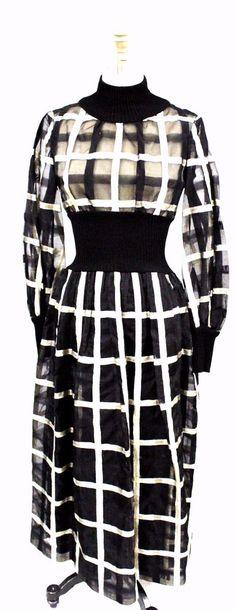 Vintage Dress, Malcolm Starr, designed by  Rizkallah, black and silver metallic organdy and cotton, 1970's  https://thebestvintageclothing.com/products/vintage-black-silver-metallic-organdy-dress-malcolm-starr-1970s-34-26-44?utm_campaign=Pinterest%20Buy%20Button&utm_medium=Social&utm_source=Pinterest&utm_content=pinterest-buy-button-10c683504-1d75-4612-9896-61c4846f990e