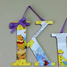 Wooden letters covered in story book pages with Mod Podge.