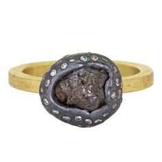 Designed by Todd Reed. Asymmetrical patina sterling silver dotted with flush-set, brilliant-cut white & brown diamonds surrounding a rough, raw diamond (3.5ct) atop an 18 karat yellow gold band. Perfect as a diamond fashion ring or a rustic, alternative bridal ring. At Alara Jewelry.