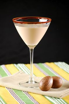 Caramel Cadbury Egg martini : 1-1/2 oz Baileys Irish Cream with Caramel, 1/2 oz crème de cacao, 1 oz caramel syrup, 1 oz cream, 1/2 tablespoon Hershey's chocolate syrup : Drizzle chocolate syrup around inside rim of glass. Place all ingredients into a cocktail shaker with ice. Shake until chocolate syrup is completely incorporated. Strain into glass.
