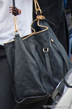 I'm not generally a fan of Louis Vuitton (over-done and ostentatious) but I do like this black embossed leather. Still really luxurious looking but not nearly as pretentious.