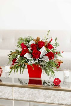 Teleflora's Winter Blooms Centerpiece | Christmas Flowers | Christmas Bouquet | Holiday Decor | #flowers #christmas Christmas Centrepieces, Christmas Arrangements, Flower Arrangements, Centerpieces, Magnolia Leaves, Christmas Flowers, Local Florist, Poinsettia, Decoration