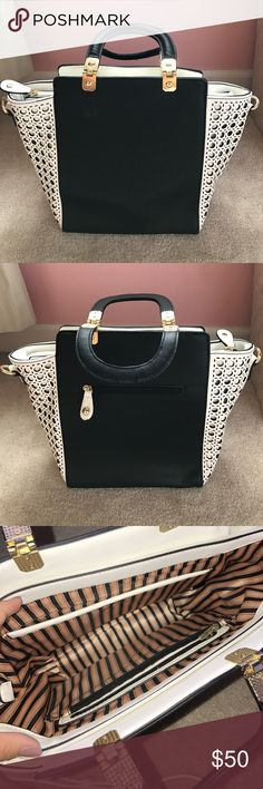 Alicia Dimichele Boutique Handbag Beautiful black and white handbag! Purchased from Alicia Dimichele Boutique. It comes with a removable and adjustable shoulder strap. Zip top. The inside has 5 pockets! The inside also has a pretty striped lining. Only used 2-3 times, so condition is like brand new! Bags Shoulder Bags