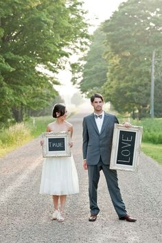 """engagement shoot prop. ornate frames with chalkboard backing. """"true love"""". DIY with ornate frames (remove glass), chalkboard paint from the hardware store or craft store, and white chalk."""