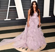 DEMI LOVATO wears petal-pink Monique Lhuillier gown,Edie Parker clutch and Dvani jewels to the Vanity Fair after party.