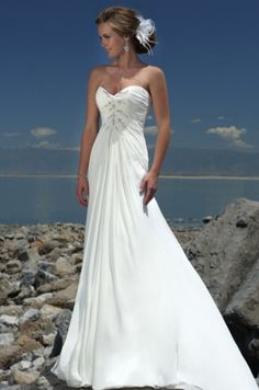 Available @ TrendTrunk.com Size 6 unaltered strapless wedding dress with small train. Only $358.00!