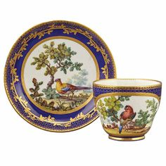 Sevres Porcelain Cup and Saucer, Circa 1765, Decorated with exotic birds on a blue ground gilded with pointille and scrolling vine, with interlaced L's mark enclosing date letter L above painter's mark for Francois-Joseph Aloncle