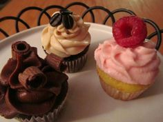 Chocolate cupcake with whiskey buttercream (on left)  Lemon cupcake with Raspberry Chambord frosting (on right)  Moccachino cupcake for people who cannot hold their liquor (behind)