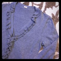 J. Crew ruffle trim cardigan Classic gray cardigan dressed up with a ruffle trim and front pockets. There is one small loose thread between the buttons and the pocket on the right side; definitely not noticeable because it is right next to the ruffles. I believe it was connected to the ruffles to make them lay flat but it came loose. Minor wash wear but otherwise great condition. Tag says medium but fits more like a small. 100% cotton! J. Crew Sweaters Cardigans