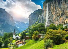 Lauterbrunnen Lauterbrunnen, Switzerland mountain tree mountainous landforms Nature mountain village sky green mount scenery vegetation mountain range valley alps hill station leaf highland canyon national park cloud landscape grass terrain tourist attraction Village hill sunlight national trust for places of historic interest or natural beauty plant bank computer wallpaper meadow elevation hillside lush surrounded