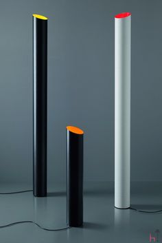 Slice is a black floor lamp shaped after a cylinder and made from carbon fibre.