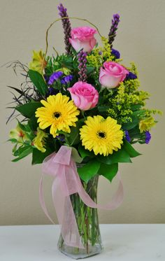 Spring flowers in yellow pink and purple. Flowers by Willow Branch Florist of Riverside