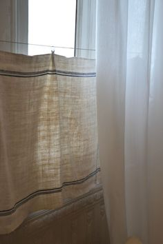 simple linen curtains - the blog is in French, but I love the look of the linen curtains - dining room?