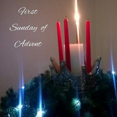The first Sunday of Advent wreath with lit candle.