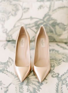 Bride's Shoes: Valentino - http://bit.ly/1HeOtQF Photography: Ruth Eileen Photography - rutheileenphotography.com   Read More on SMP: http://www.stylemepretty.com/2016/01/26/blogger-bride-jessye-of-city-tonics-colorful-diy-wedding/