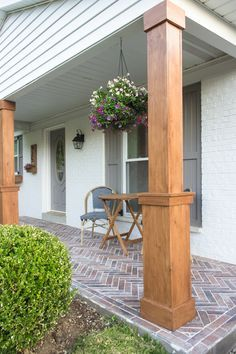 DIY Craftsman Style Porch Columns - Shades of Blue Interiors - - How to wrap existing porch columns in stained wood and build a craftsman style base unit to add character and curb appeal to your front porch. House Columns, Porch Pillars, Front Porch Columns, Modern Farmhouse Porch, Farmhouse Front Porches, Farmhouse Landscaping, Farmhouse Style, Modern Front Porches, Yard Landscaping